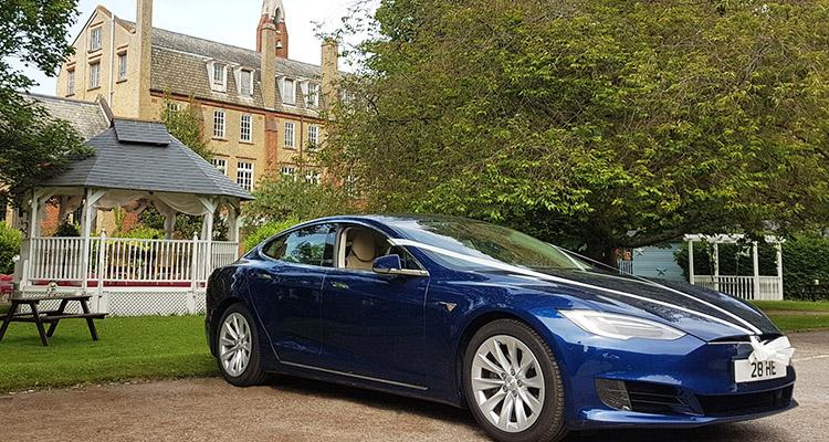 Blue Tesla Wedding Car