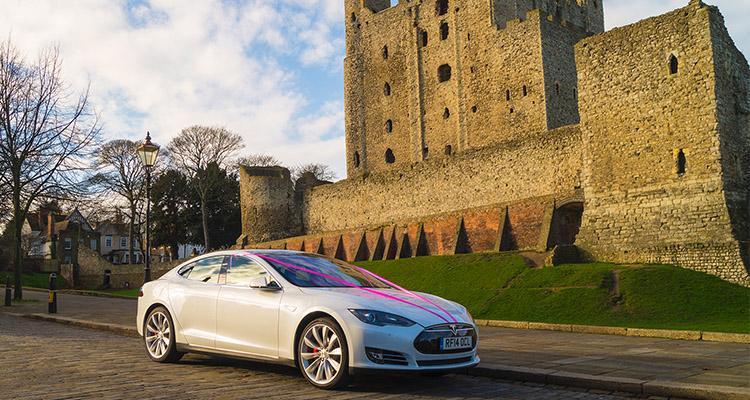 White Tesla Pink Ribbon Wedding Car