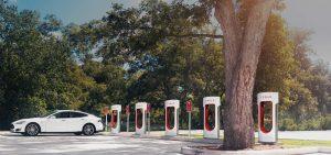 White Tesla at Tesla Supercharger